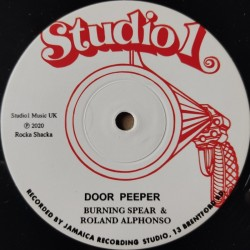 Burning Spear & Roland...